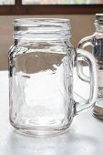 picture of mason  - Empty glass mason jars on the table - JPG