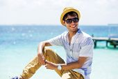 stock photo of casual wear  - Young man at the beach wearing casual clothing - JPG