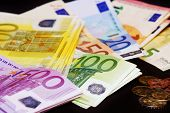 pic of passbook  - Close up of a Euro banknotes and coins - JPG