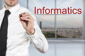 image of informatics  - businessman in office writing informatics in the air - JPG
