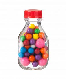 stock photo of gumballs  - Multicolored gumballs bubble gums close up  on white - JPG