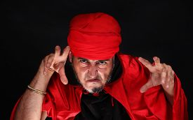 stock photo of sorcerer  - Hypnotist or sorcerer is doing hypnosis or magic with eyes and hands - JPG
