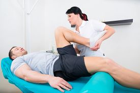 image of therapist  - Patient at the physiotherapy doing physical exercises with his therapist - JPG