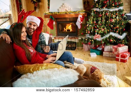 Young couple shopping on line for Christmas