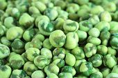 picture of green pea  - Close up of a pile of coated green peas - JPG