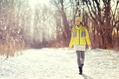 Winter happy woman walking in snow outdoors nature. Joyful young person relaxing on an outdoor walk  poster