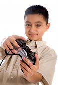 stock photo of video game  - Child playing video games with a black controller over a white background - JPG