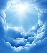 stock photo of divine  - blue sky with sun and beautiful clouds - JPG