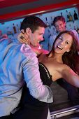 image of night-club  - Couple Having Fun In Busy Bar - JPG