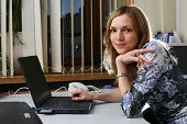 stock photo of blinders  - Young woman in office - JPG