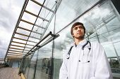 stock photo of health-care  - Portrait of a doctor outdoors - JPG
