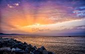 Sunbeams At Sunrise On The Beach. Colors In The Sky. poster