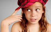 picture of newsboy  - Young girl in plaid cap looking serious and thoughtful - JPG