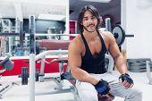 Smiling Bodybuilder In A Gym poster