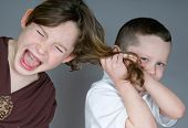 Bully boy pulling girl's hair