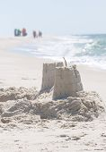PERDIDO KEY, FL - JUNE 9: A sandcastle is shown as BP oil spill workers (background) clean the beach