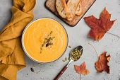 Pumpkin Soup Puree Or Cream Soup In Bowl. Autumn Comfort Food On Concrete Background. Warming Bowl O poster