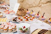 Candy Bar. White Wedding Cake Decorated By Flowers Standing Of Festive Table With Deserts, Strawberr poster