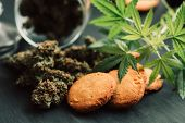 Cannabis Buds On A Black Background. Baking With The Addition Of Cbd. Sweets With Weed. Cookies With poster