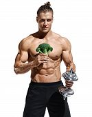Sporty Man Holding Broccoli And Dumbbell As Symbol Healthy Lifestyle. Photo Of Muscular Man With Nak poster
