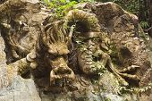 stock photo of emei  - A chinese stone dragon statue on the rock - JPG