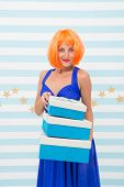 Carnival And Holidays Season. Woman Red Ginger Wig Blue Dress Hold Pile Gift Boxes. Birthday Gift. L poster