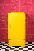 Bright Yellow Refrigerator In Pink Interior. Retro Fridge Looks Awesome In Modern Interior. Stylish  poster