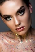 Elegant Glamorous Girl Posing With Glitter On Body, Isolated On Grey poster