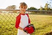 A boy holding baseball mitt and smiling to camera poster