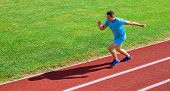 Sprinter Training At Stadium Track. Runner Captured In Midair. Short Distance Running Challenge. Boo poster