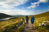 Tourist Friends On A Top Of Mountains In A Scottish Highlands. Scotland Nature. Tourist People Enjoy poster
