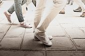 Faded To Top Impressionist Background Image Legs And Footwear Of Tourists On The March, Walking Thro poster