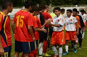 KAPOSVAR, HUNGARY - JULY 21: Competitors shake hands  at the VIII. Youth Football Festival U16 Final