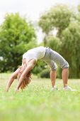 picture of bending over backwards  - Woman bending over backwards - JPG