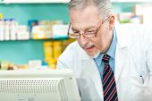 Pharmacist using a desktop computer