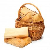Wicker basket with cut logs fire wood from Silver Birch tree (Betula Pendula). Renewable resource of