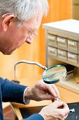 stock photo of hearing  - hearing aid acoustician at work - JPG