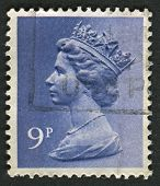 UK-CIRCA 1976:A stamp printed in UK shows image of Elizabeth II is the constitutional monarch of 16