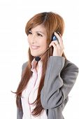 Friendly secretary or telephone operator on white background.