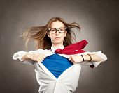 stock photo of hero  - woman opening her shirt like a superhero - JPG