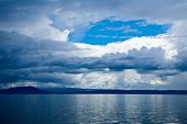 Moody sky with stormy clouds over Lake Taupo in the North Island of New Zealand