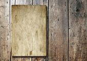 Vintage old grungy paper banner over ancient wood background