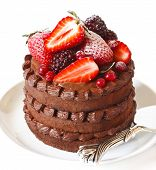 pic of sponge-cake  - Delicious chocolate cake with cream and berries on a white background close up - JPG