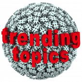 image of hash  - The words Trending Topics on a ball or sphere of hash tags to illustrate hot news - JPG