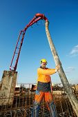 picture of formwork  - builder worker standing near trailer - JPG