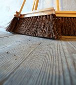 stock photo of household farm  - Close up large brooms for house work on old wooden floor of country house. Sweeping