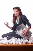 picture of discard  - Woman with lots of discarded paper - JPG