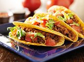 foto of tacos  - three beef tacos with cheese - JPG