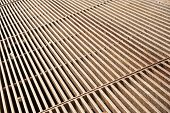 picture of metal grate  - The thick rusty metal grate with a rough texture - JPG