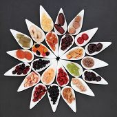 picture of elderberry  - Dried fruit selection in white dishes over slate background - JPG